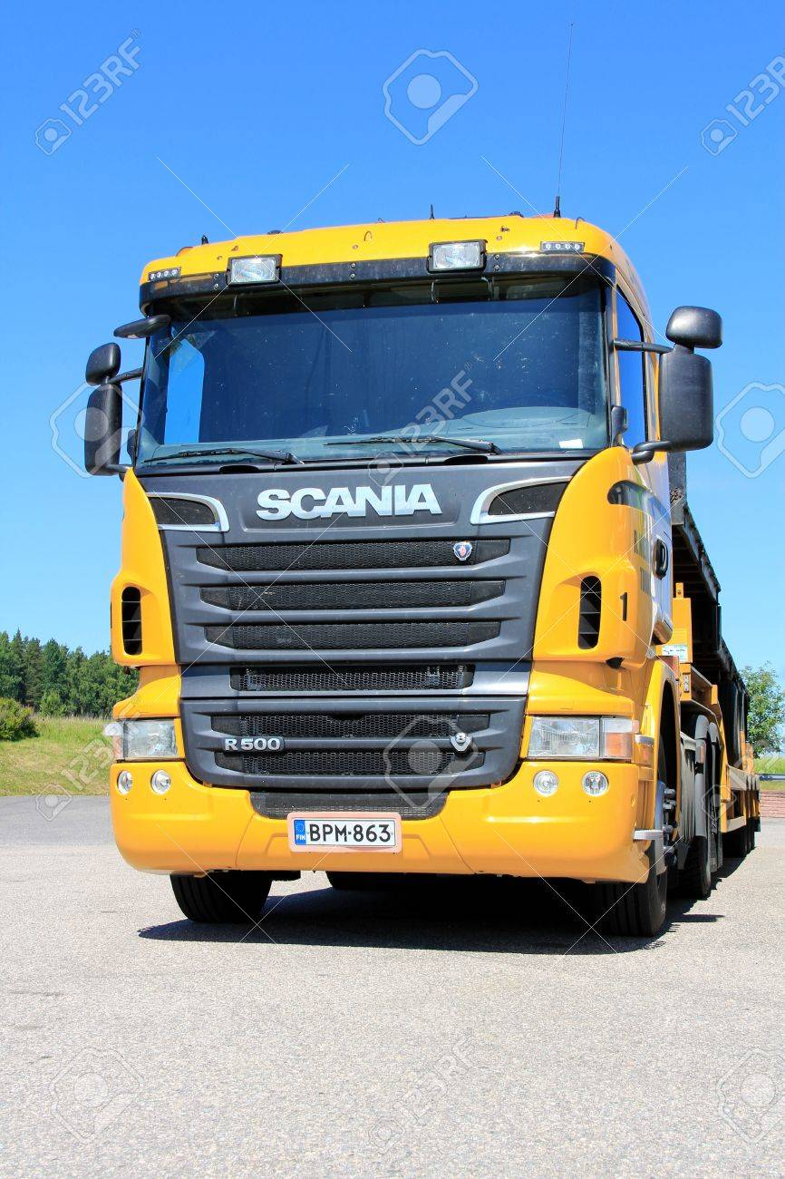 SALO, FINLAND - JUNE 21, 2013: Scania R500 Vehicle carrier parked in Salo, Finland on June 21, 2013.  According to press release dated June 20, Scania delivers worlds first Euro 6 gas truck to customer. Stock Photo - 20473912