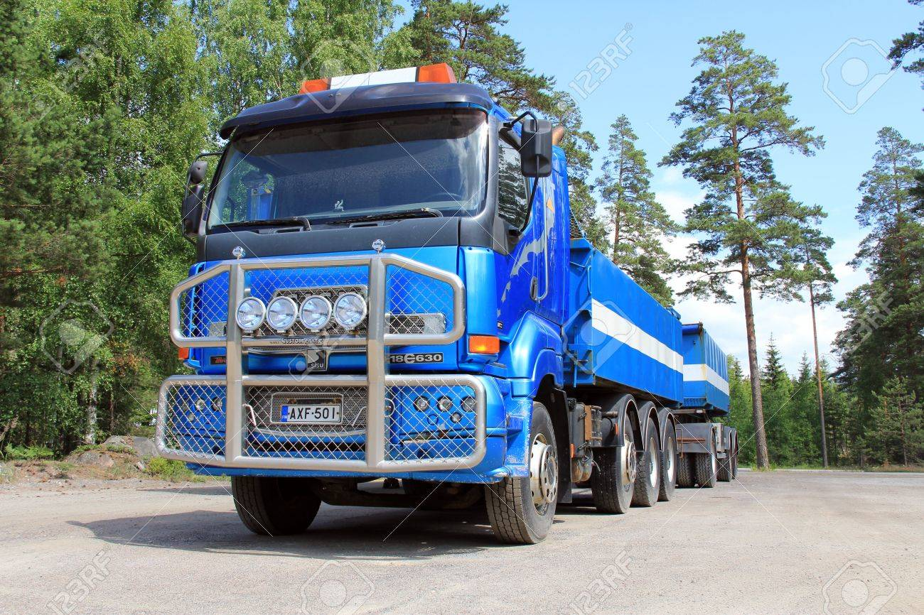 TAMMISAARI, FINLAND - JULY 6, 2013: Sisu 18E630 heavy duty truck parked in Tammisaari, Finland on July 6, 2013. Sisu Auto Finland prepares for a peak in demand for Euro 5 series of trucks due to the new Euro 6 emission regulation coming into force next ye Stock Photo - 20684421
