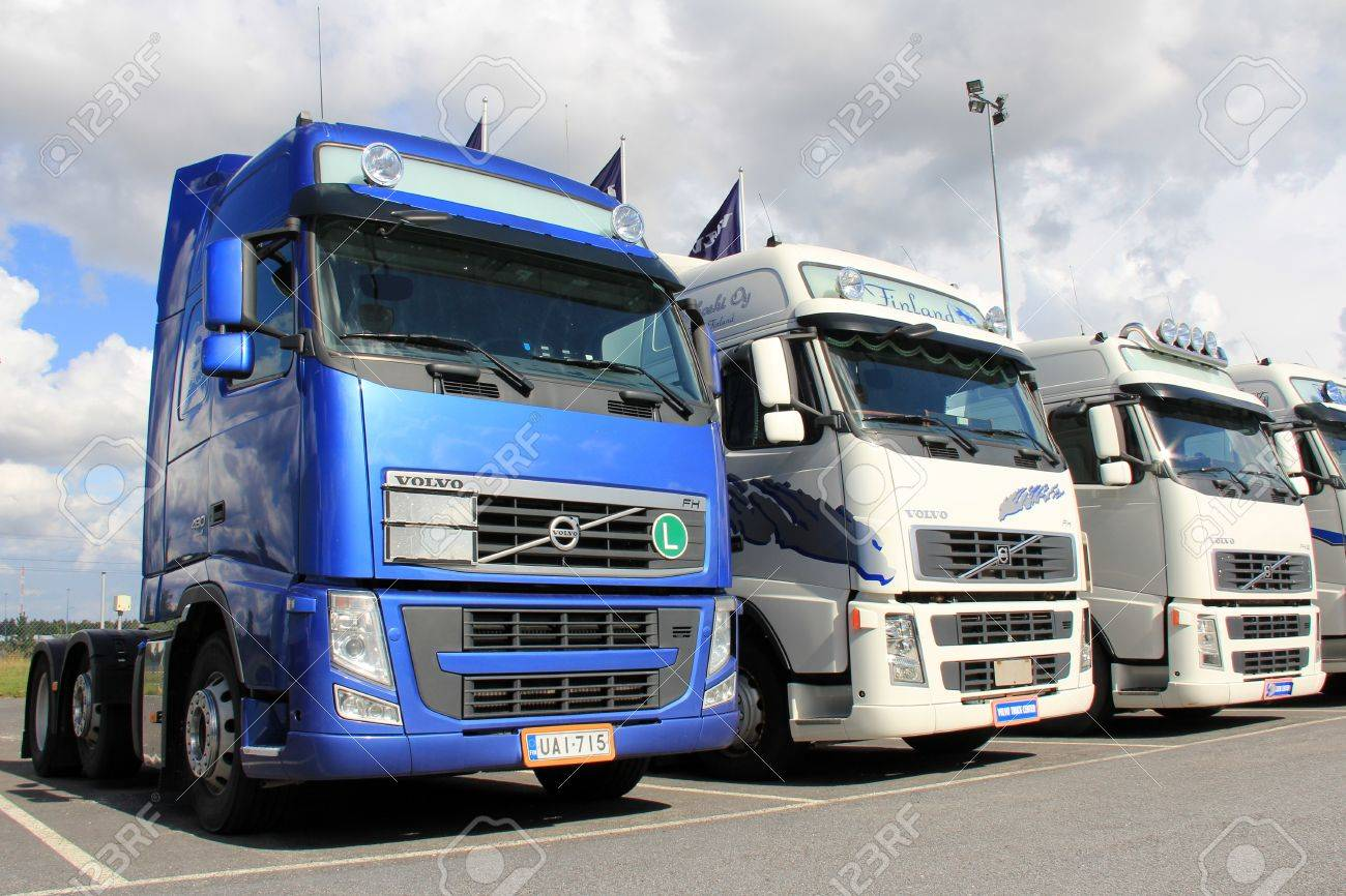 LIETO, FINLAND - AUGUST 31  Row of Volvo trucks on August 31, 2013 in Lieto, Finland  According to Volvo Group, one third of all goods traffic on the European roads involves the transport of food  Stock Photo - 21843734