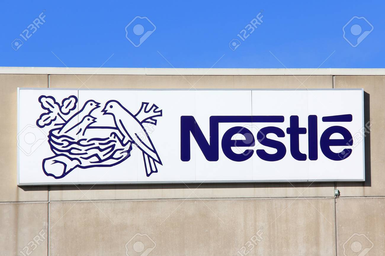 TURKU, FINLAND - OCTOBER 6: Sign Nestle at Suomen Nestle Factory on October 6, 2013 in Turku, Finland. Nestle S.A. is a Swiss multinational food and beverage company, and the largest food company in the world measured by revenues. Stock Photo - 22656865