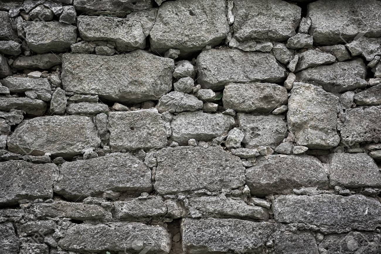 Old Stone Bricks Wall Texture Background. Vintage Dark Toned Stock Photo,  Picture And Royalty Free Image. Image 68262299.