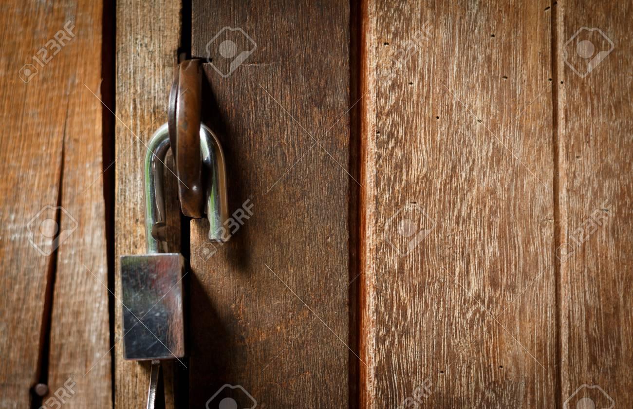 Unlock key on wooden door, Padlock on a wooden door Open lock