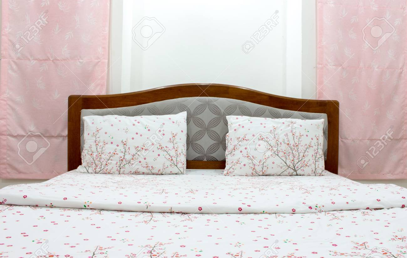 Close Up White Pillow And Bedding Sheets On Natural White Wall