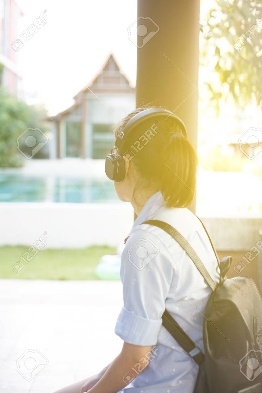 Girl listening music with headphone sitting alone asian girl style stock photo 69770851