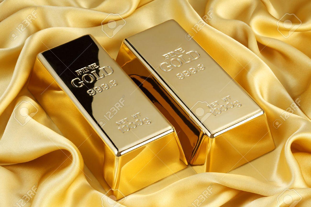 Gold bars on golden silk - 45451782