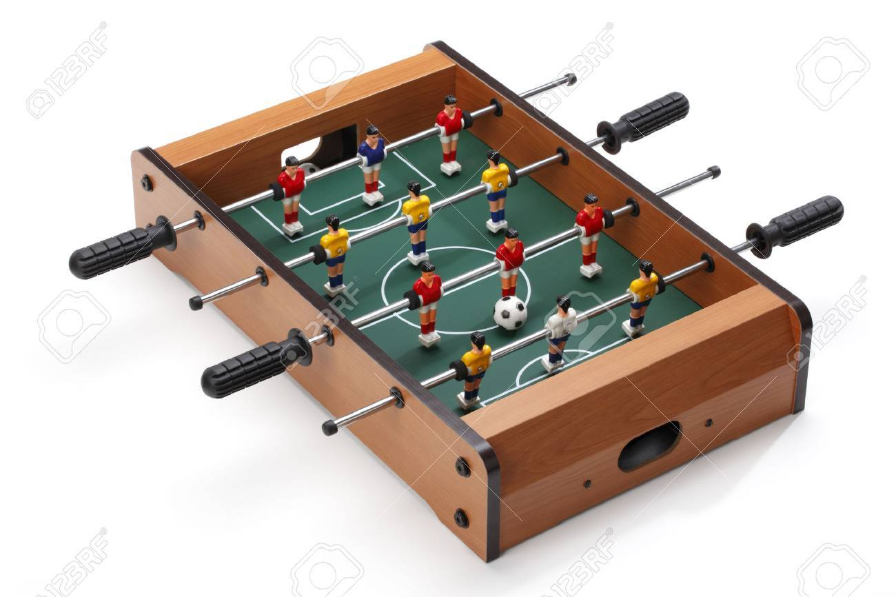 Table soccer Football players on the grass field background. Table game. - 46190502