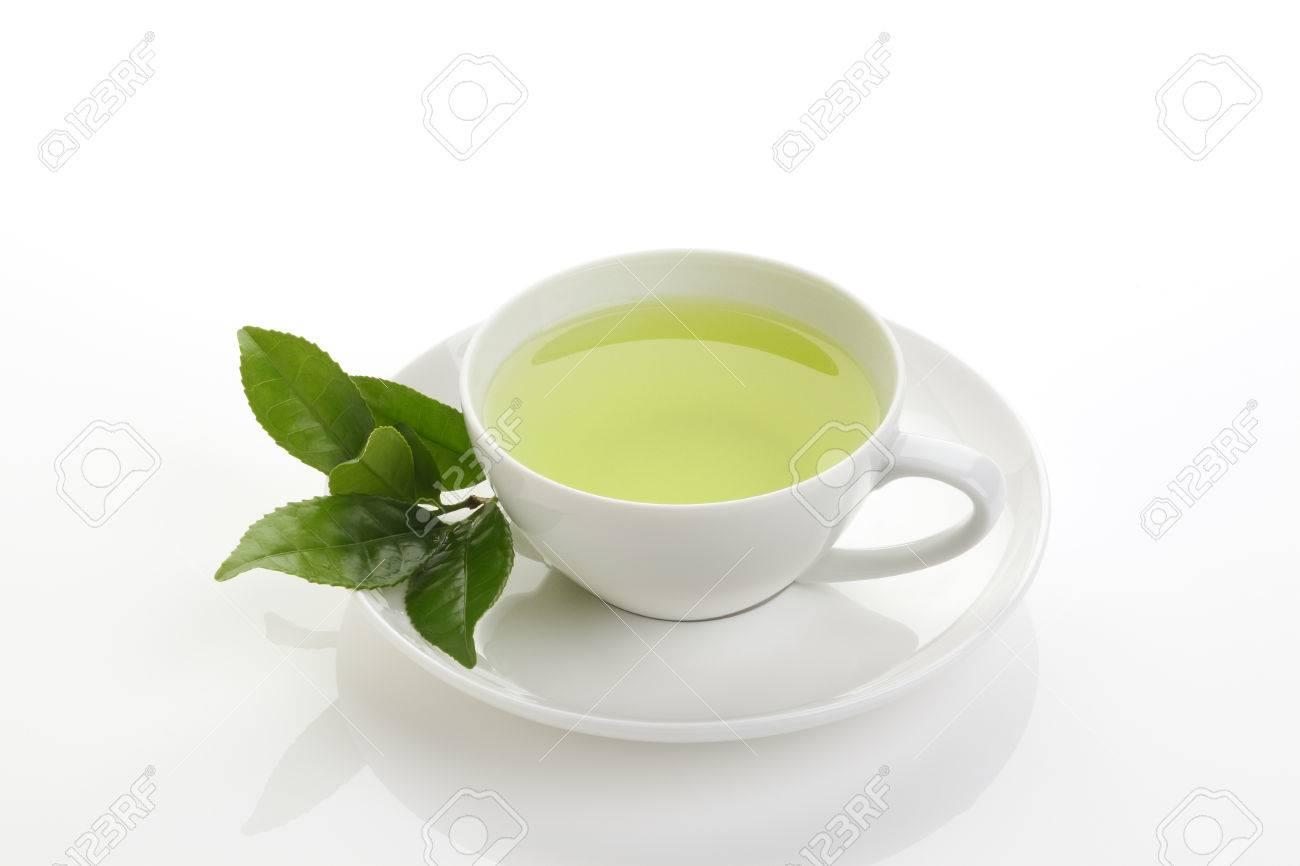 Japanese green tea and fresh green tea leaves on white background - 46190842