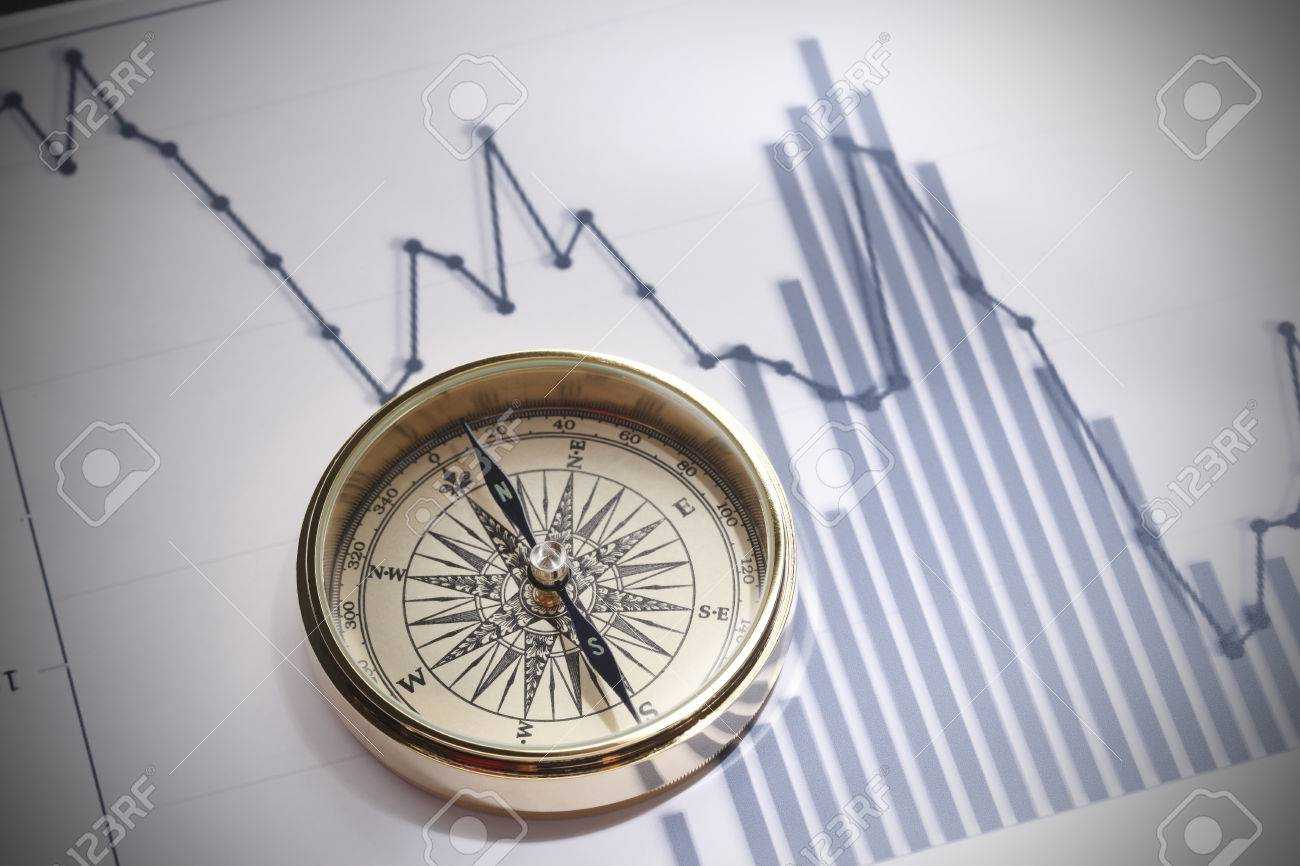 Close-up of a compass on stock market data chart - 46289661