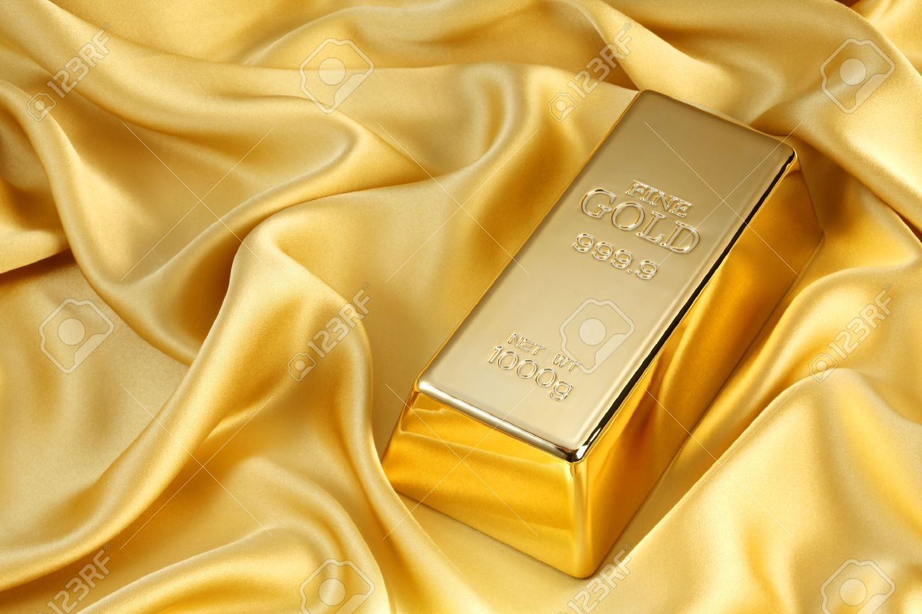 Photo of a 1kg gold bar on gold satin - 46617750