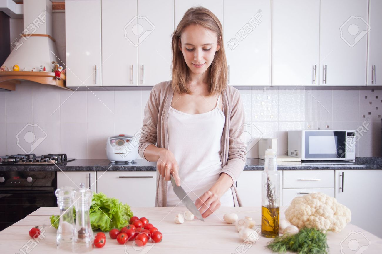 Home Kitchen Cooking Young Woman Cooking In The Kitchendieting Vegetarian Concept