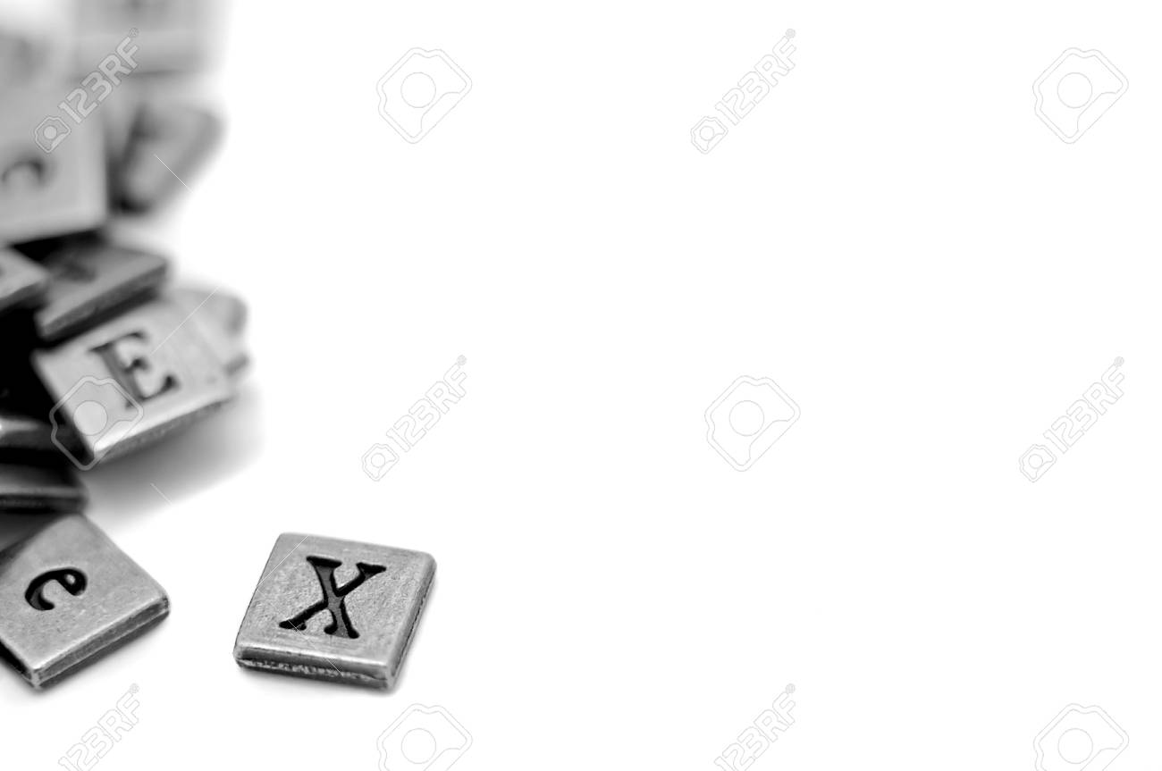 Metal Scrapbooking Letters Laying On A White Background Stock Photo