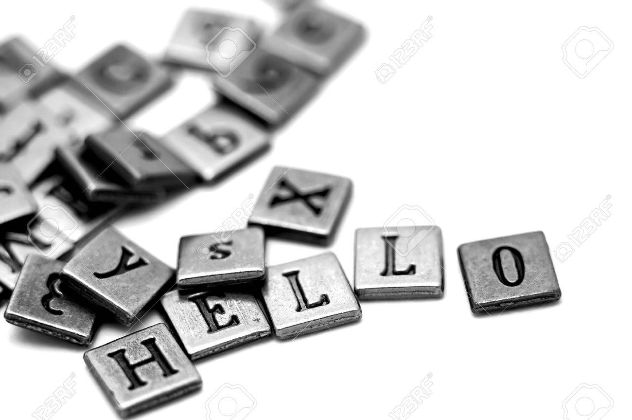Metal Scrapbooking Letters Spelling Hello They Lay On A White