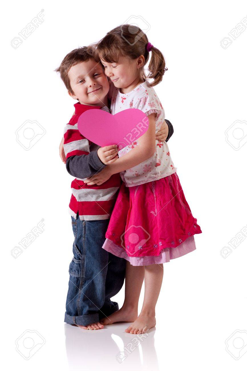 Cute little children hugging and holding a pink heart Stock Photo - 18576908