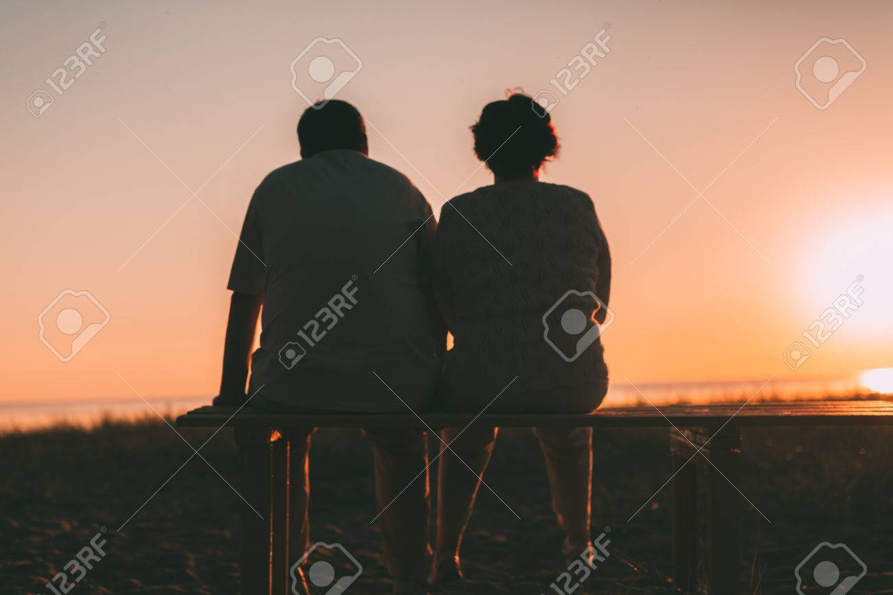 Back View A Married Couple A Silhouette Sitting On A Bench. Evening ... for bench silhouette back  103wja