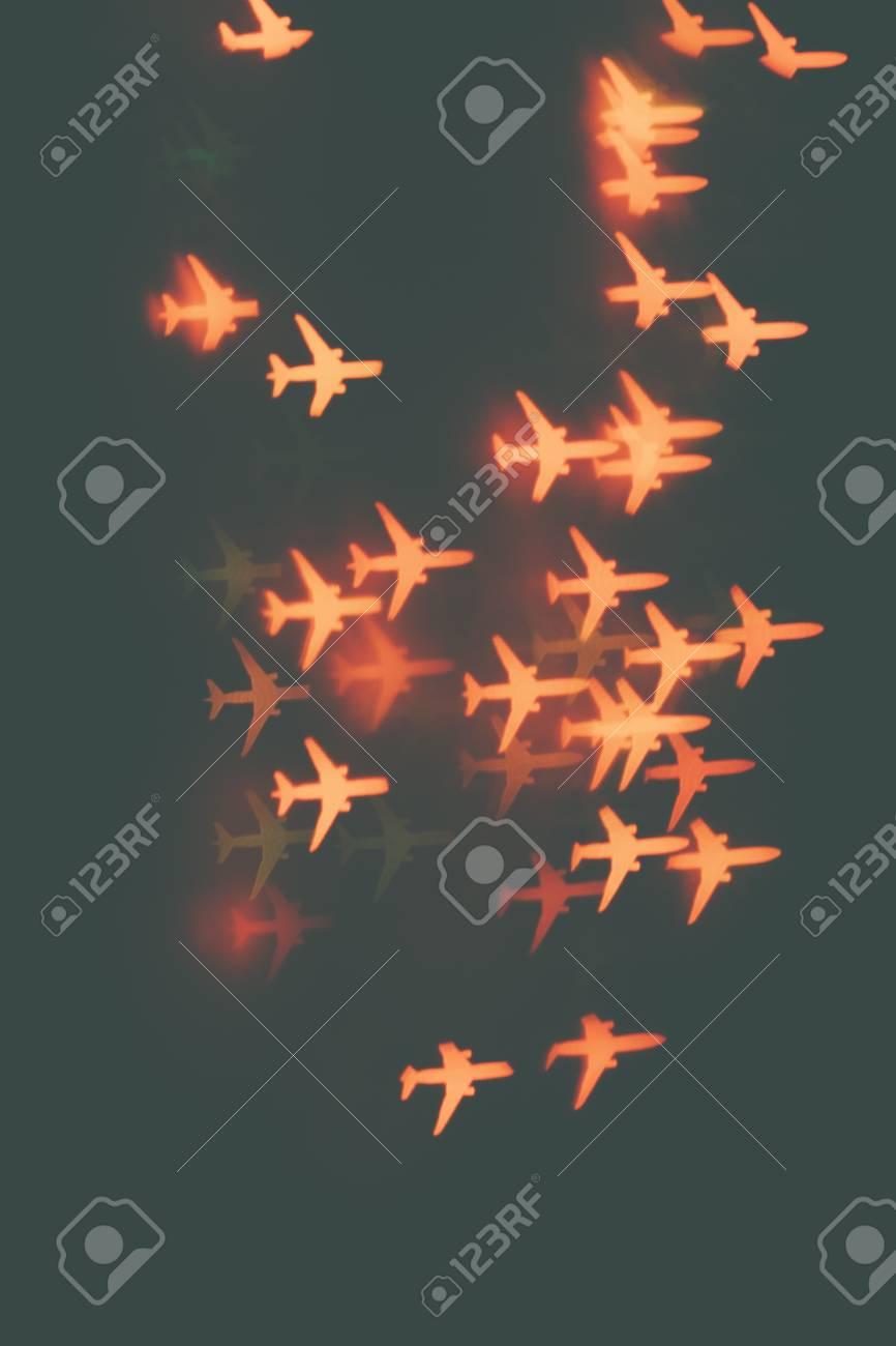 55892824 many orange airplanes on a dark background design wallpaper