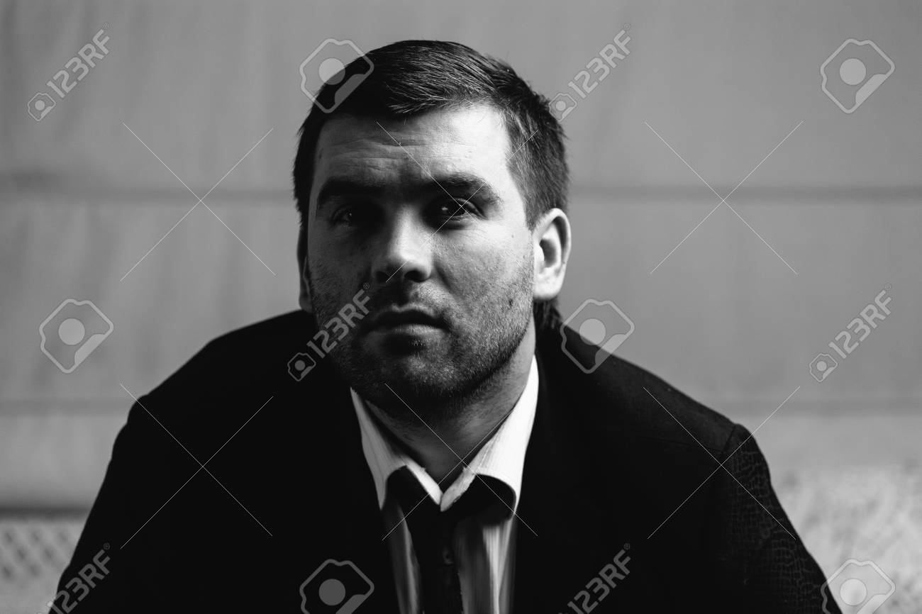 Serious man close up portrait black and white photography stock photo 70006723