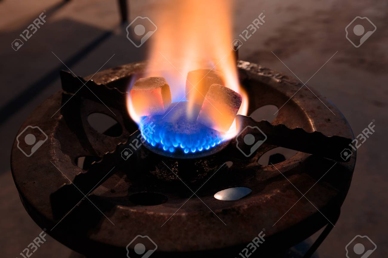 charcoal for shisha on a gas burner stock photo picture and royalty