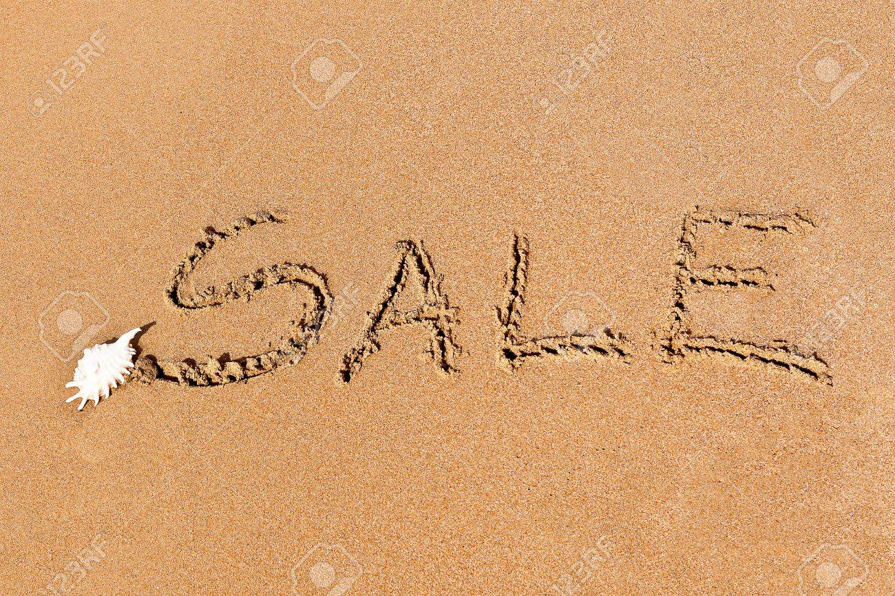 written sale drawn on the sand on the beach with shell Stock Photo - 20214207