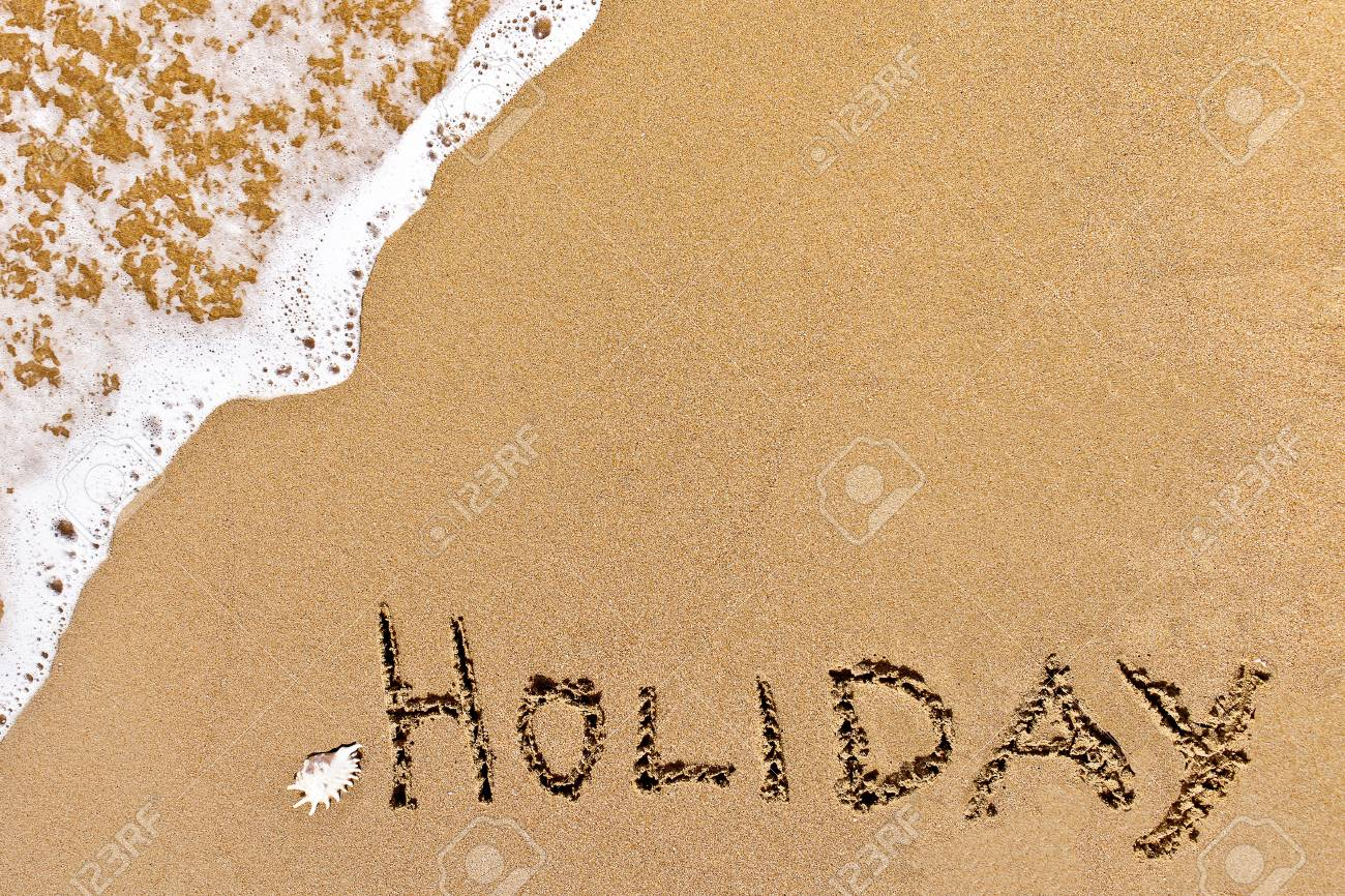 written holiday drawn on the sand on a beach Stock Photo - 20212448