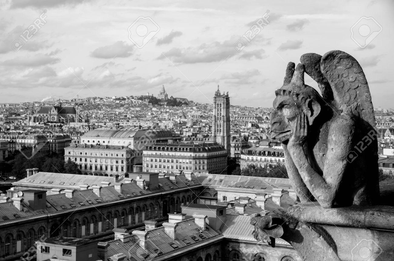 Gargoyle on the top of notre dame de paris black and white stock