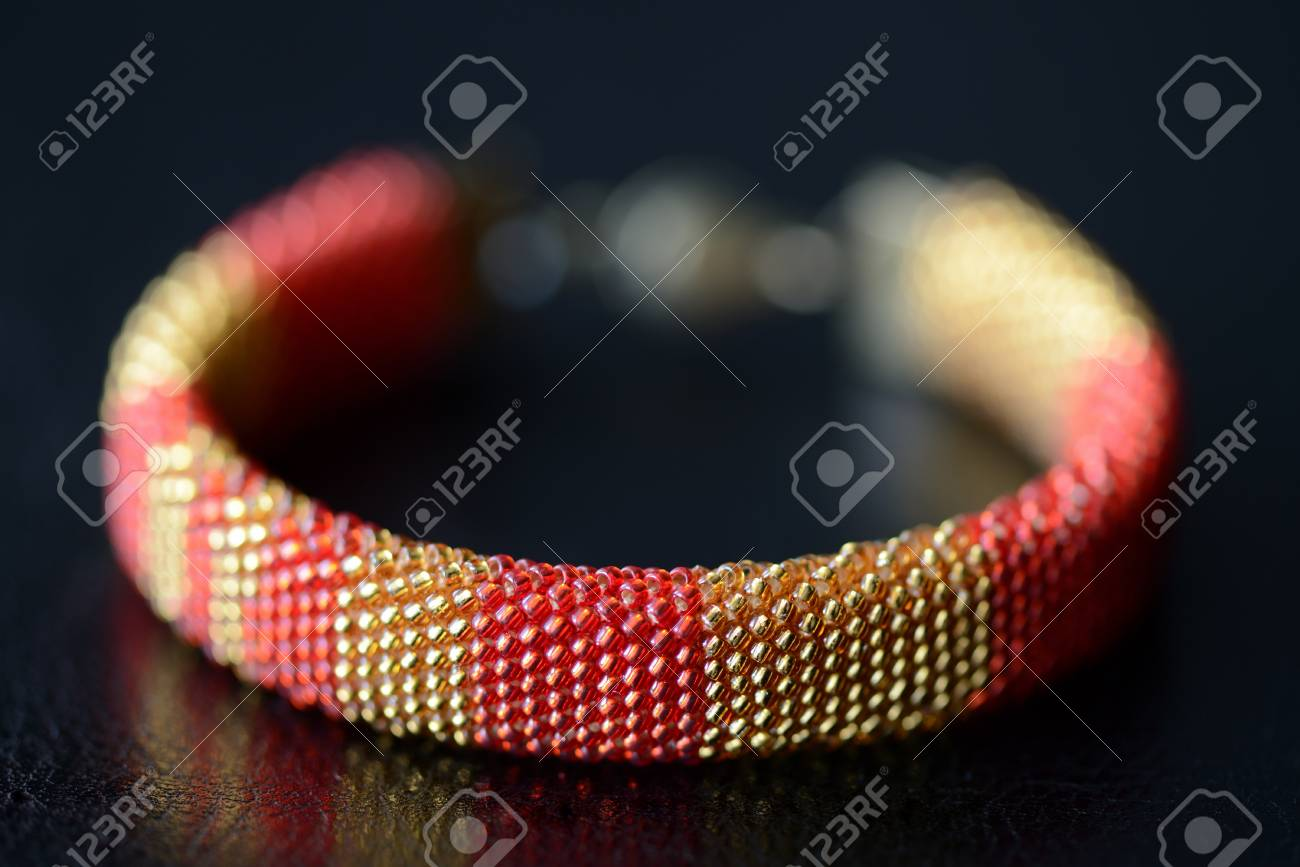Red And Yellow Shiny Bracelet Made Of Small Seed Beads Close Stock Photo Picture And Royalty Free Image Image 94725362
