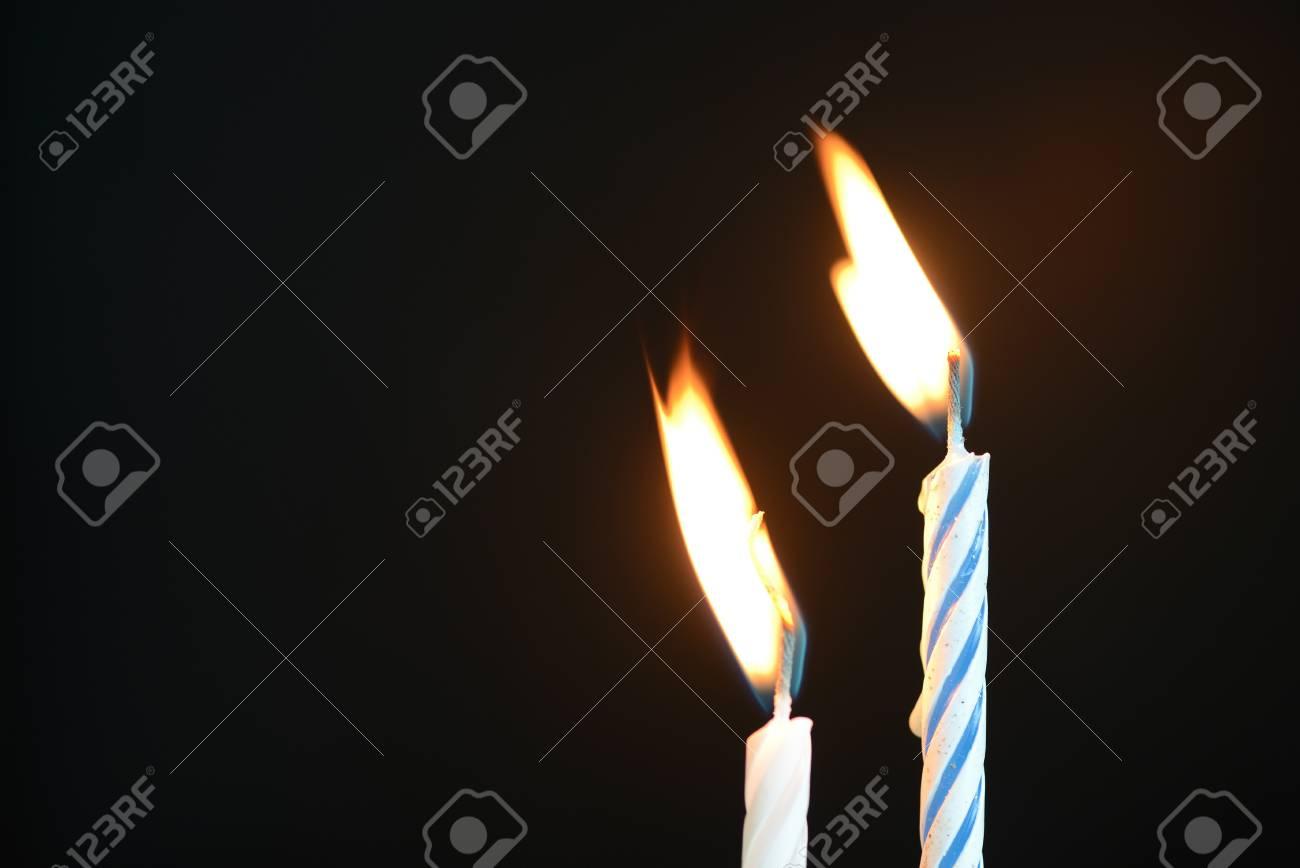 Two Birthday Candles Against A Dark Background Close Up Lizenzfreie