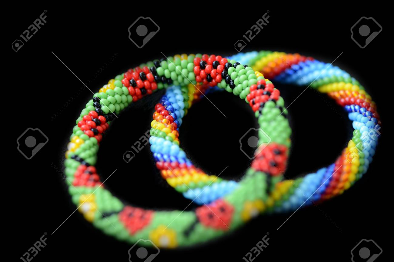 Two Kid S Summer Bracelets Made Of Seed Beads Isolated On A Black Stock Photo Picture And Royalty Free Image Image 119553685