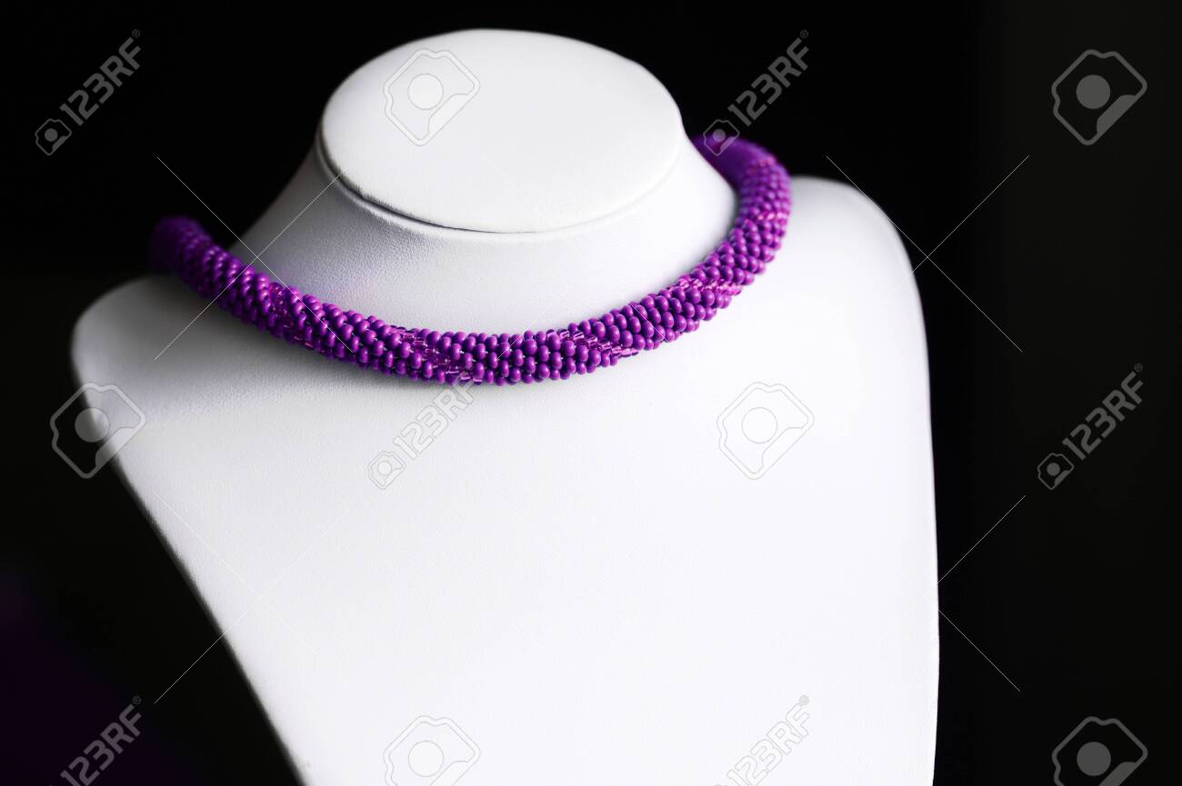 Purple Necklace Made Of Seed Beads On A Dark Background Close Up Stock Photo Picture And Royalty Free Image Image 129439062