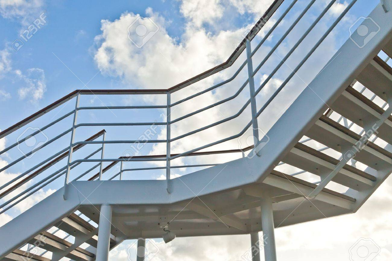 Metal staircase with blue sky - 17990978