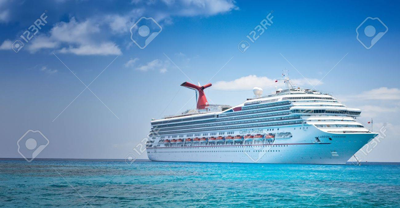 Grand Cayman, Cayman Islands - July 13, 2011: Carnival's Ship, Carnival Freedom, anchored off the coast of Grand Cayman. Passengers have to be tendered to the island for day excursions. - 22459579