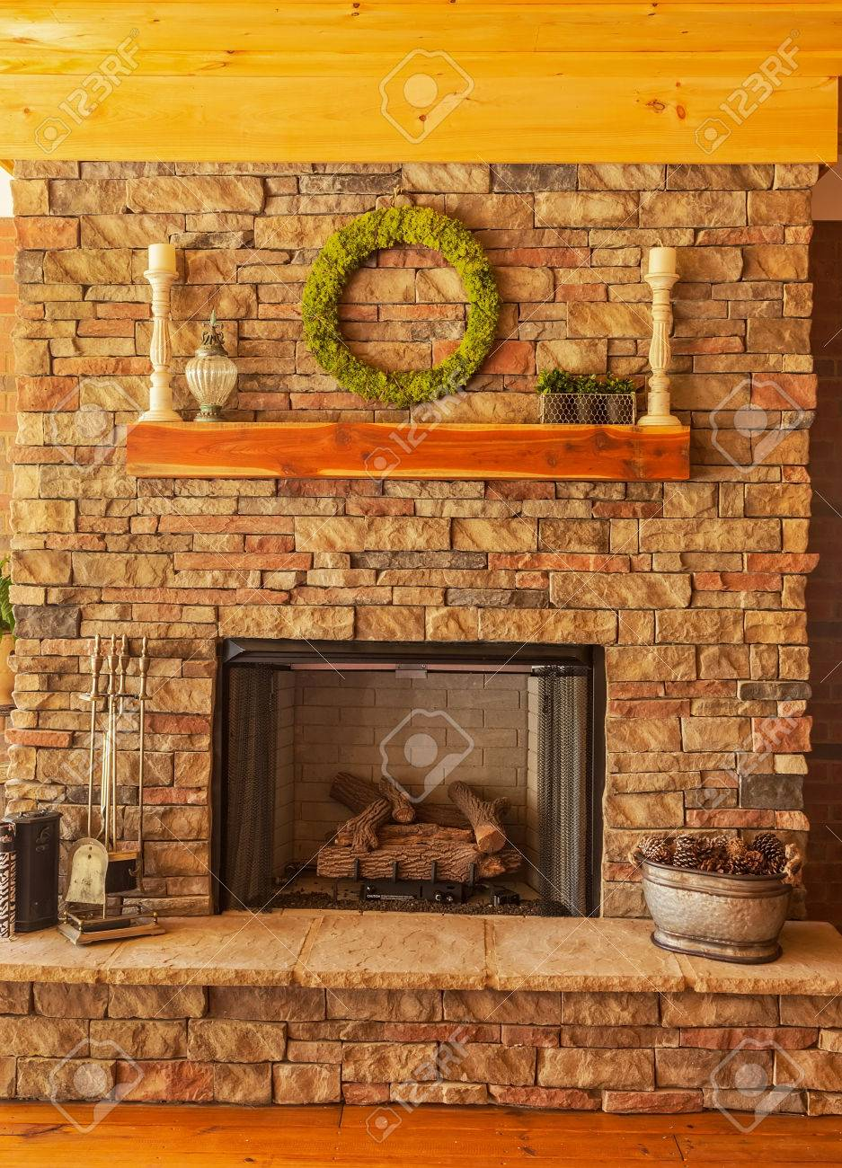 Large stone gas fireplace on interior deck stock photo 27295675