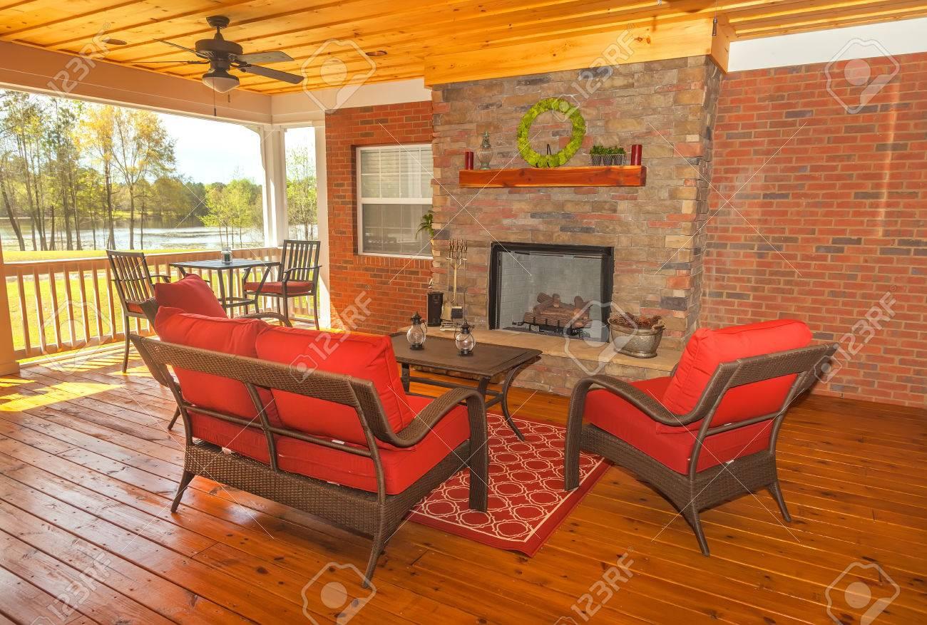 Screened in backyard deck with furniture overlooking lake - 35297798
