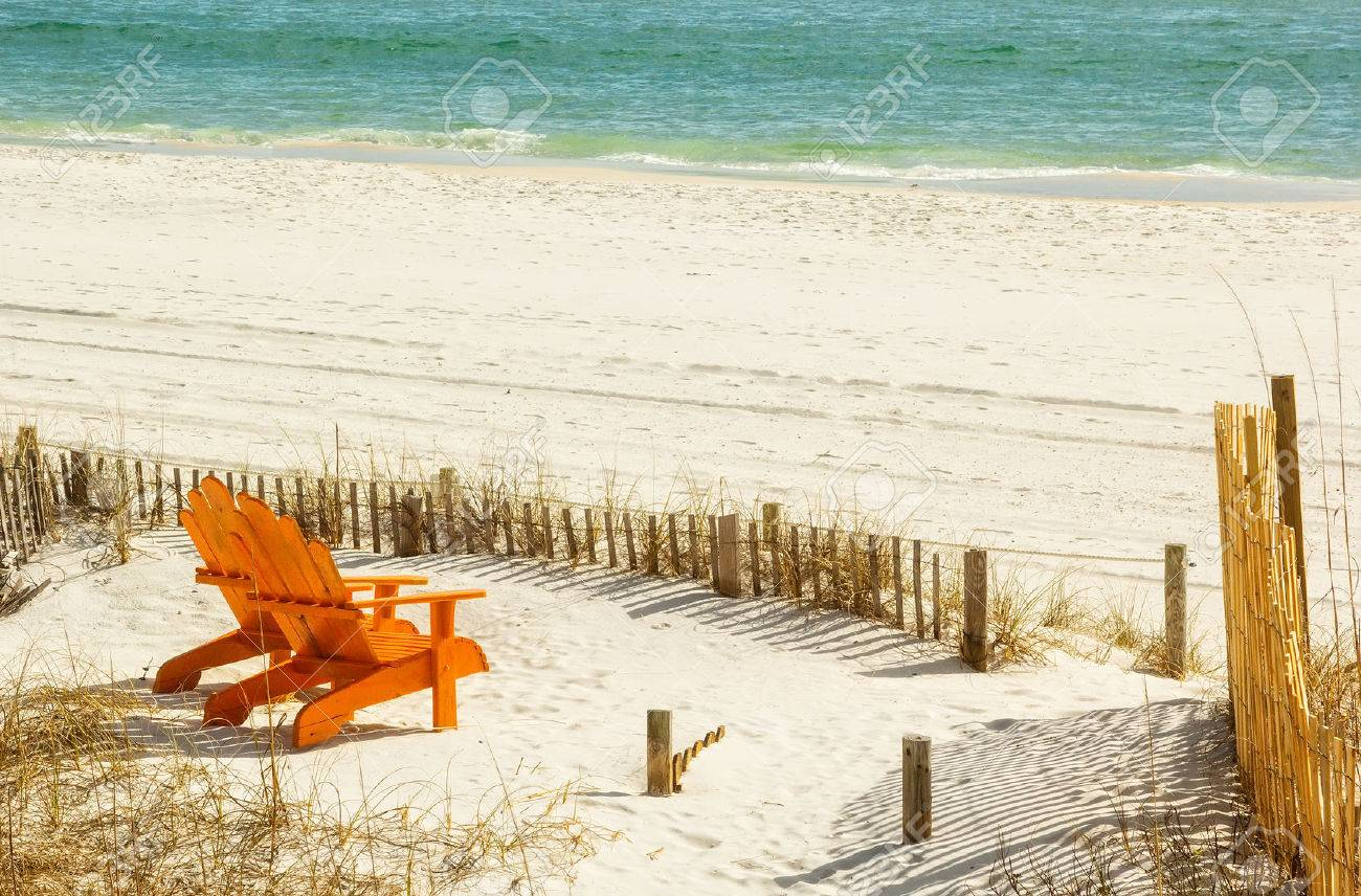 Charmant Pair Of Adirondack Chairs On Panama City Beach In Panama City, Florida  Stock Photo