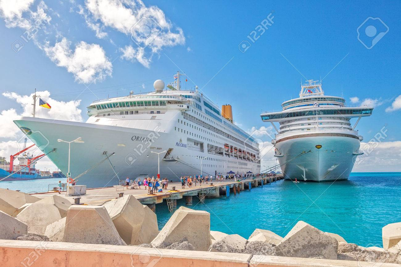 Philipsburg, St. Maarten - Jan. 16, 2013: Cruise ships docked at Dr. A. C. Wathey Pier on the Dutch side of St. Maarten. Passengers wanting to go to town are tendered to the smaller Captain Hodge Pier in Philipsburg. - 28616990
