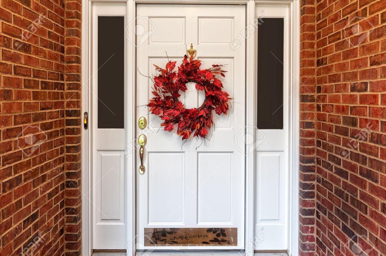 Red Autumn Wreath On Front Door Walkway Stock Photo   34392129
