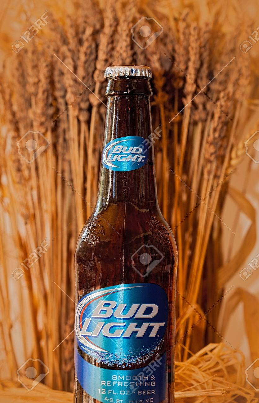 7, 2014: Bottle Of Bud Light Beer, From Anheuser Busch Bottling C., With  Soft Wheat In The Background.