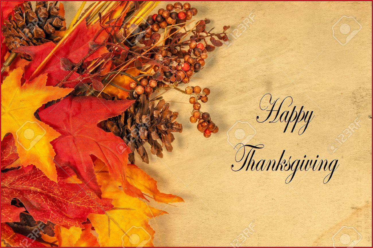 A Happy Thanksgiving card, with autumn decorations and text - 35693552