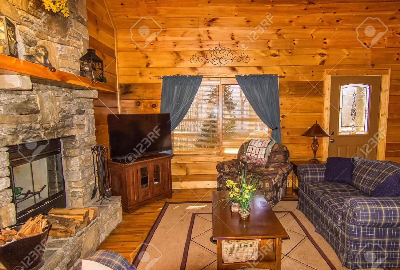 Cabin interior fireplace - Interior Of Log Cabin With Stone Fireplace And Seating Area Stock Photo 35933648