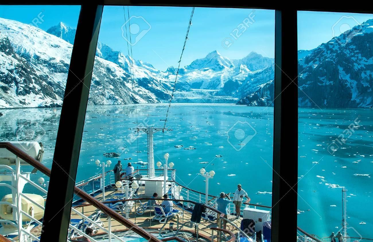 Glacier Bay, Alaska - June 1, 2009: View through a cruise ship window of a glacier in Glacier Bay. Passengers take in the scenic view before cruise ship departs. - 56159889