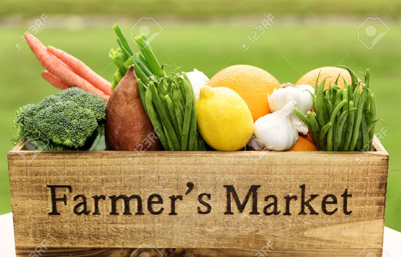 Variety of fresh produce in a Farmer's Market wooden box. - 112486301