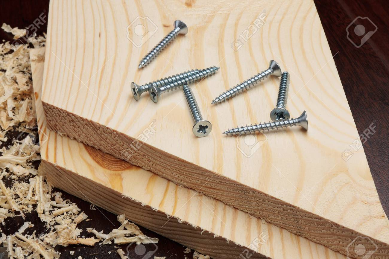 Several screws on wooden planks Stock Photo - 8376911