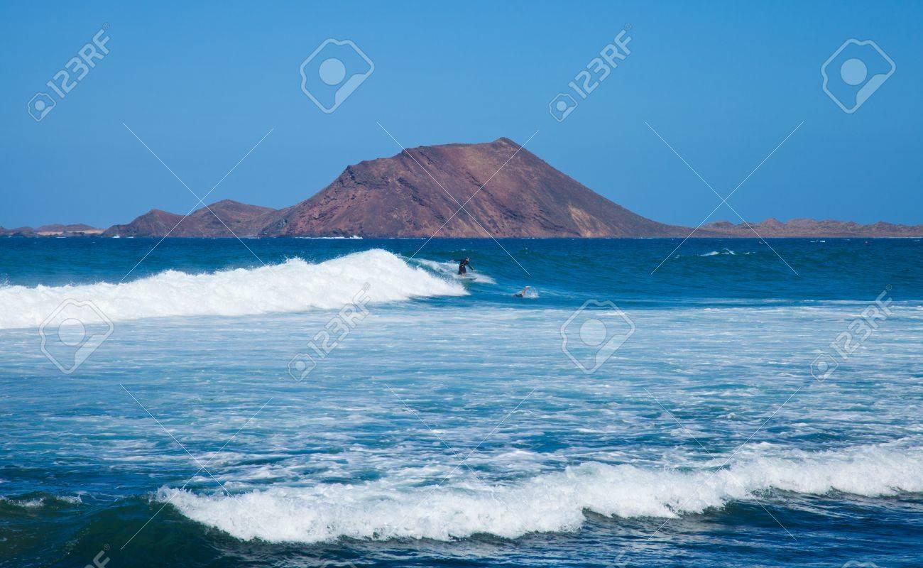 Fuerteventura, September 2012 - group of surfers enjoys sea swell off the North Coast of Fuerteventura, Isla de Lobos in the background Stock Photo - 15319138