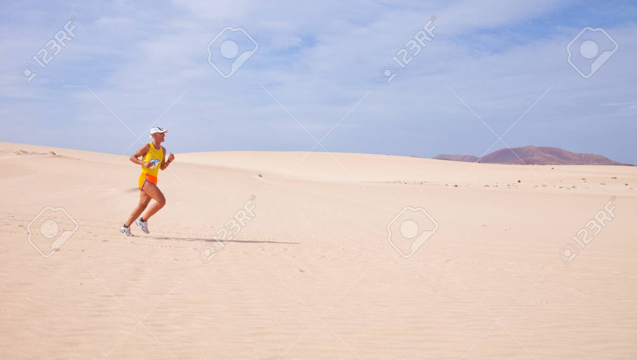 CORRALEJO - NOVEMBER 03: Participants running in the dunes at Fourth international Fuerteventura half-marathon 03 November, 2012 in Corralejo, Fuerteventura, Spain Stock Photo - 16224664
