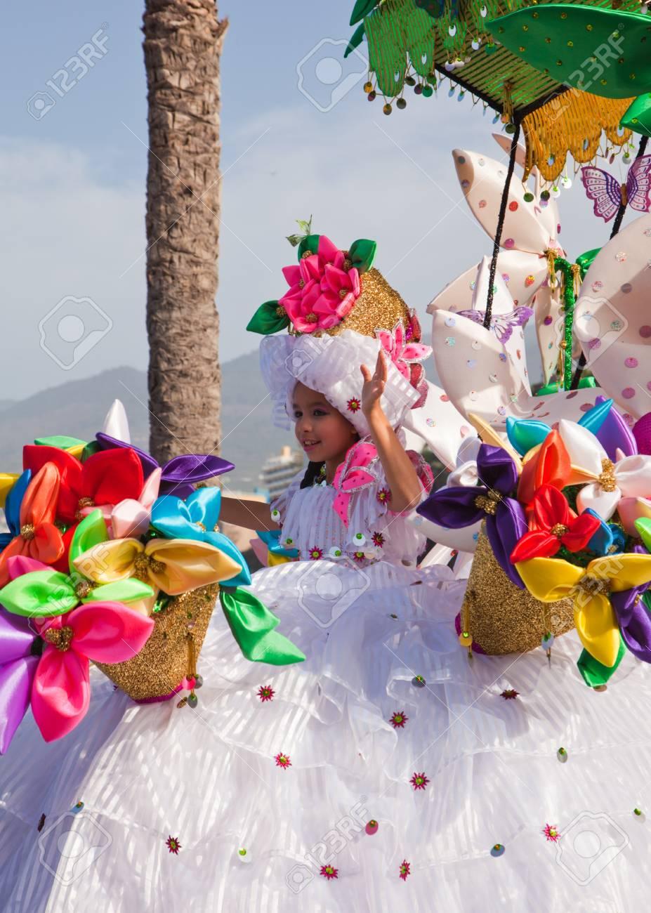 PUERTO DE LA CRUZ, SPAIN - February 16: Colorfully dressed participants take part in main carnival parade on February 16, 2013 in Puerto de la Cruz, Tenerife, Spain Stock Photo - 18471351