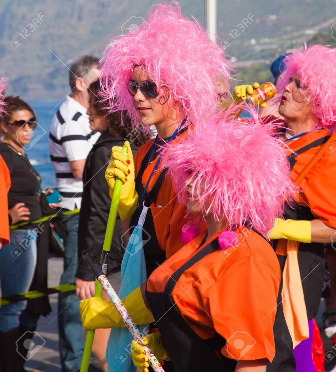 PUERTO DE LA CRUZ, SPAIN - February 16: Colorfully dressed participants take part in main carnival parade on February 16, 2013 in Puerto de la Cruz, Tenerife, Spain Stock Photo - 18509406