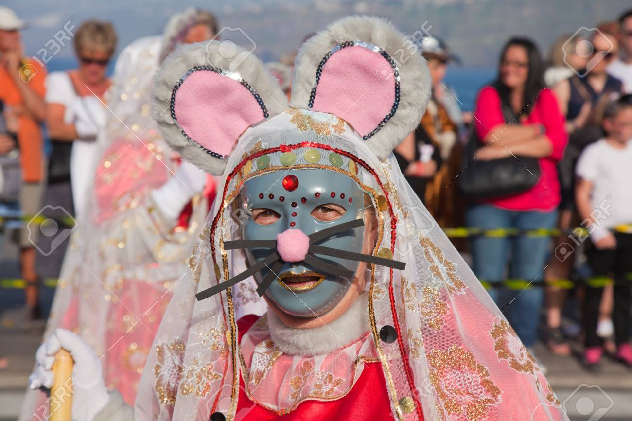PUERTO DE LA CRUZ, SPAIN - February 16: Colorfully dressed participants take part in main carnival parade on February 16, 2013 in Puerto de la Cruz, Tenerife, Spain Stock Photo - 18509891