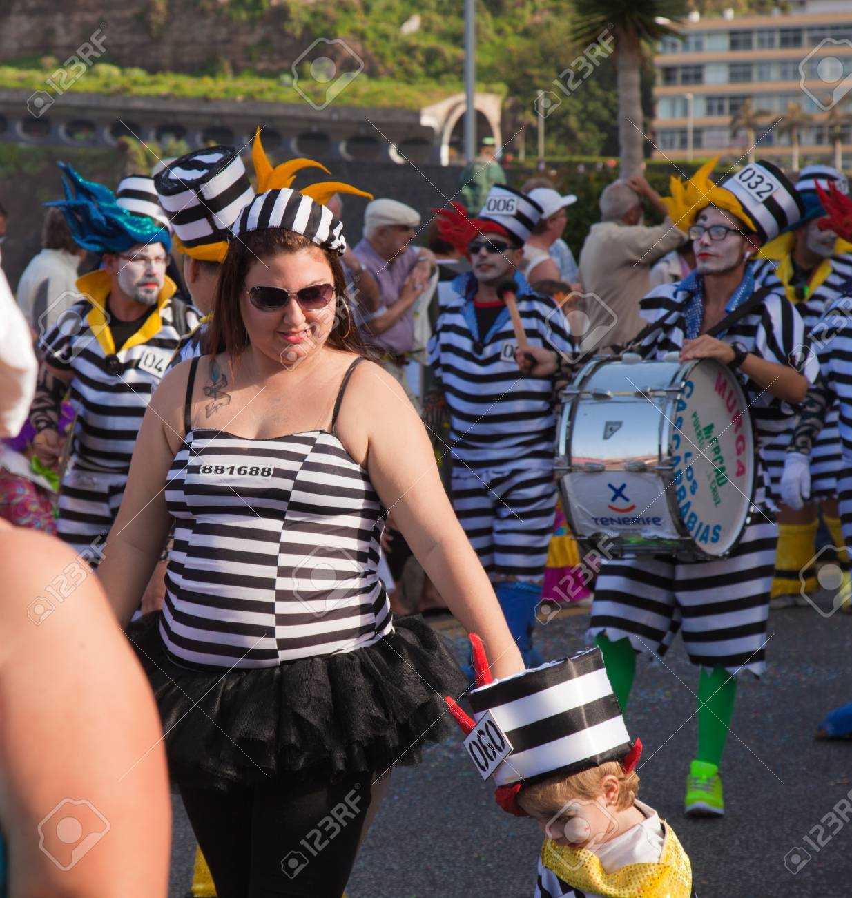 PUERTO DE LA CRUZ, SPAIN - February 16: Colorfully dressed participants take part in main carnival parade on February 16, 2013 in Puerto de la Cruz, Tenerife, Spain Stock Photo - 18535847