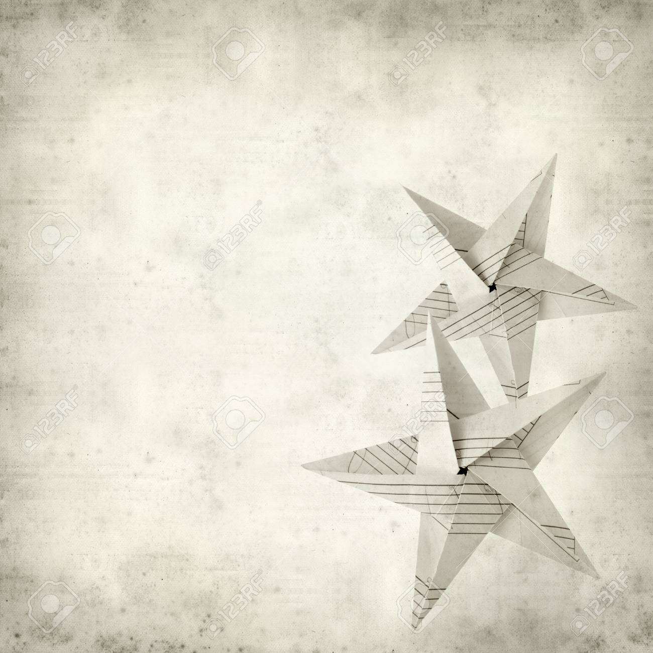 textured old paper background with folded paper star stock photo