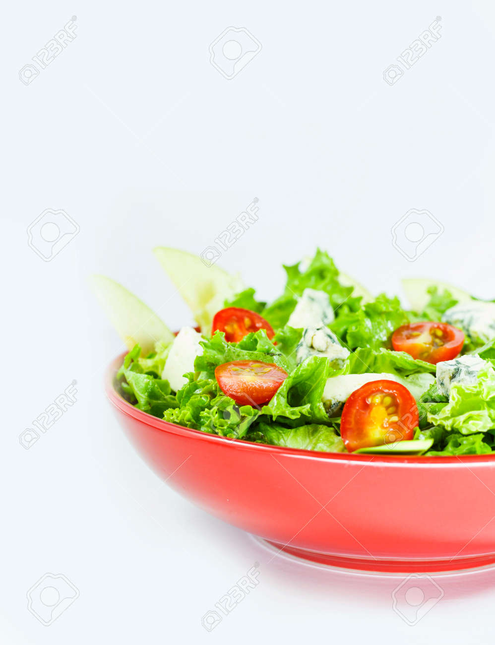 Vegetarian salad with tomatoes, cheese, lettuce. Vegetables in the red bowl. Delishes food. - 149602149