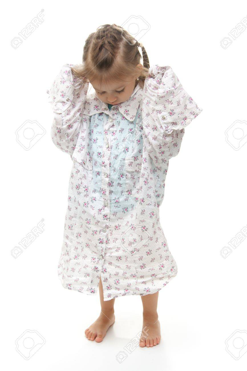 Young girl wearing big shirt on isolated white background Stock Photo - 8271185